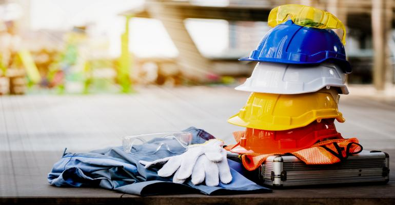 Gloves and hard hats and goggles—essential construction gear