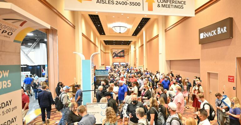 Attendees approach and enter the Expo Hall as IRE 2021 kicked off